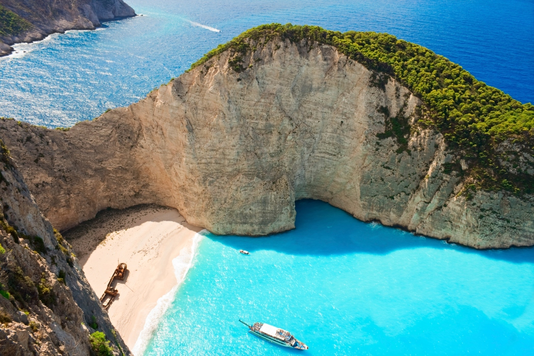 shipwreck beach with blue water and cliffs greece