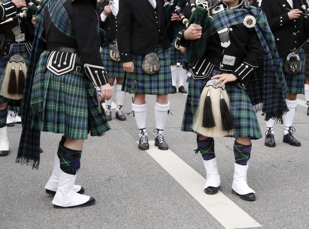 Bagpipe players wearing kilts