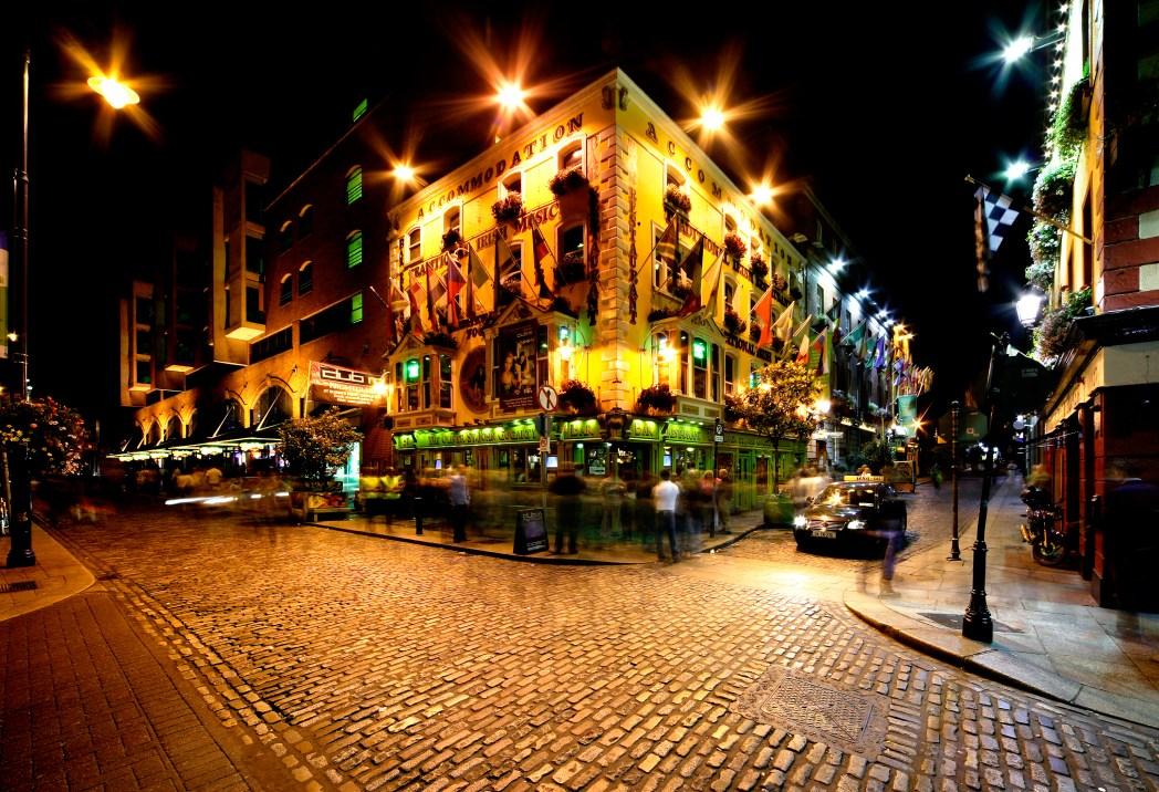 bar lit up at night in dublin