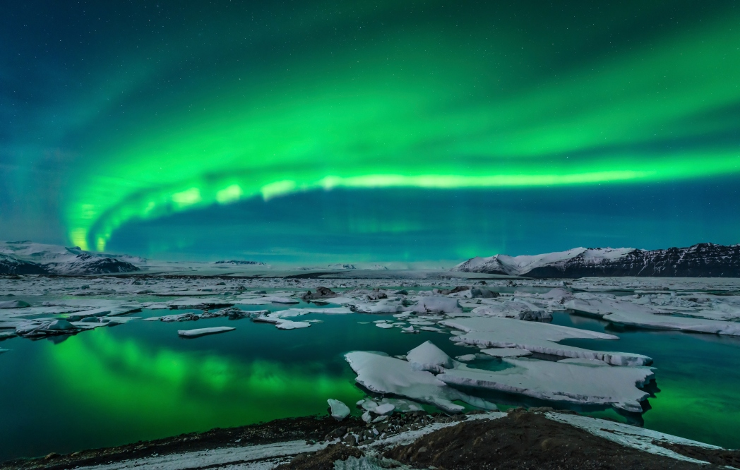 Aurora borealis above Jökulsárlón Glacier Lagoon in Iceland